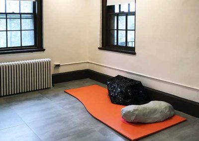 "Rita Leduc, Rocks on an Arguably Solitary Journey (II), (installation shot at Bethany, mixed media, approx. 90"" x 36"" x 20"", 2020"